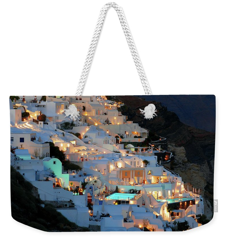 Tranquility Weekender Tote Bag featuring the photograph Oia, Santorini Greece At Night by Marcel Germain