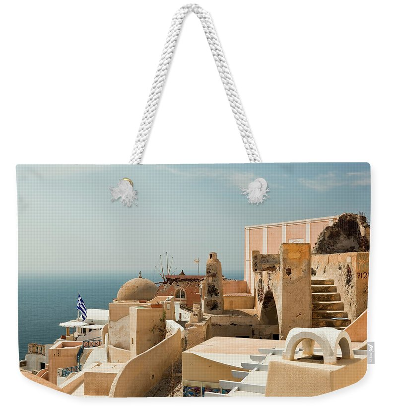 Steps Weekender Tote Bag featuring the photograph Oia Town by Property Of Olga Ressem.