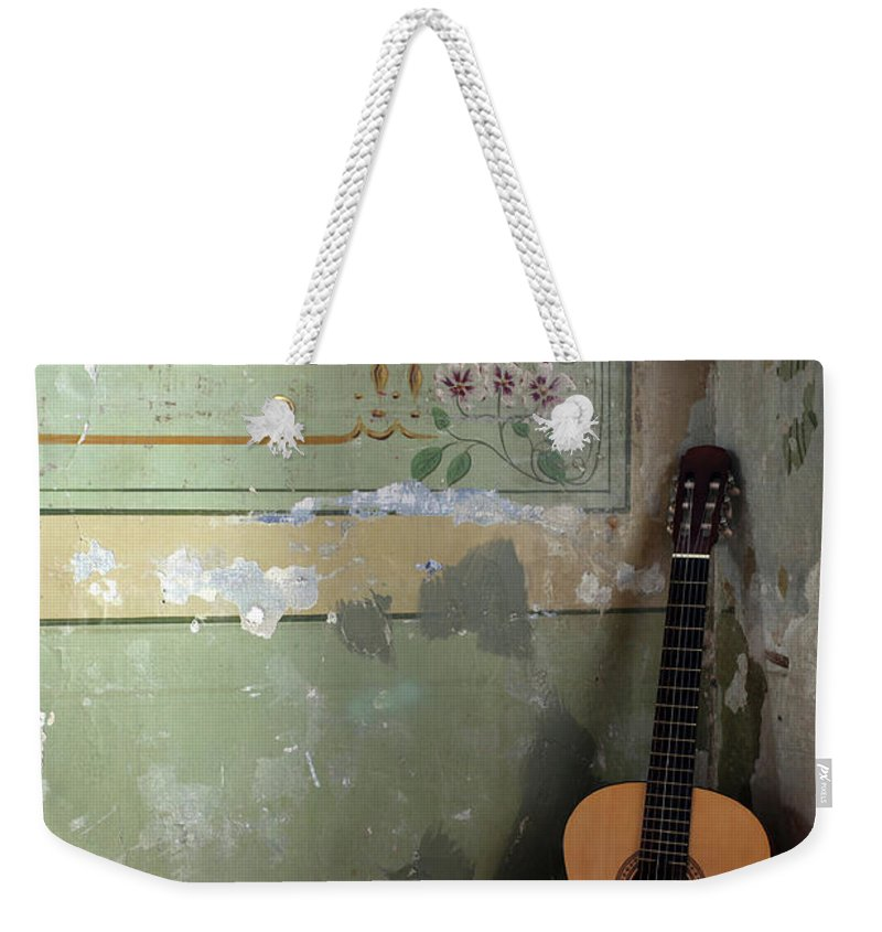 Music Weekender Tote Bag featuring the photograph Old Guitar by Kursad