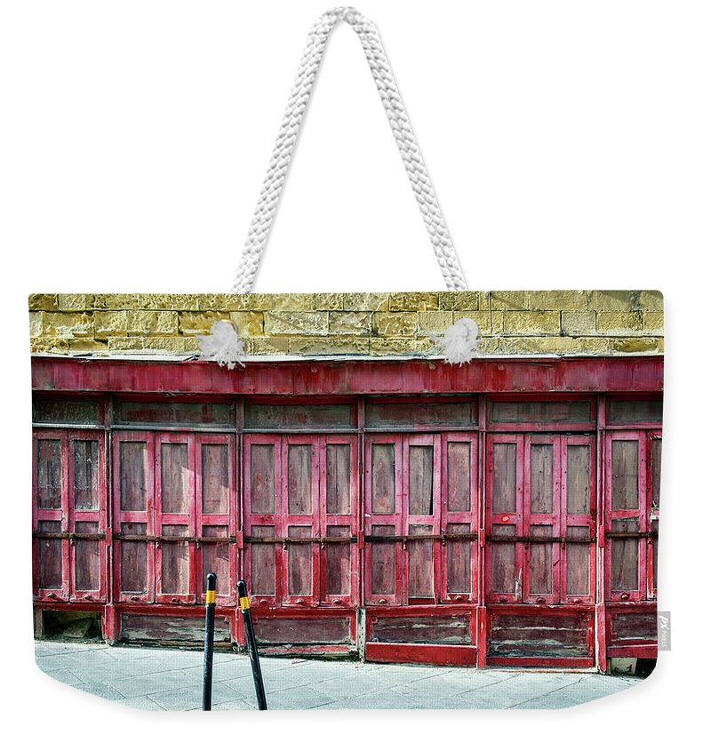 Finance And Economy Weekender Tote Bag featuring the photograph Old Store Front by Foottoo