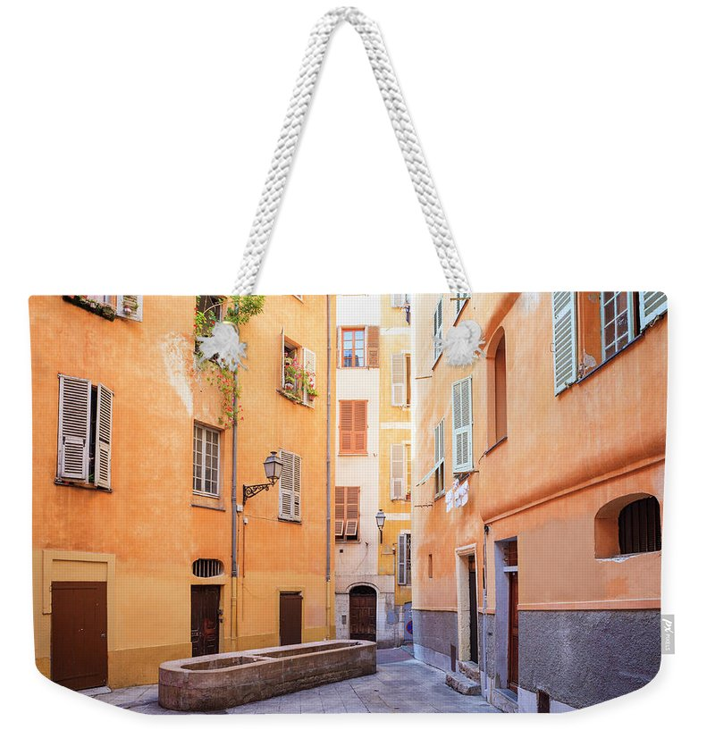 Orange Color Weekender Tote Bag featuring the photograph Old Town Of Nice, French Riviera, France by Aprott
