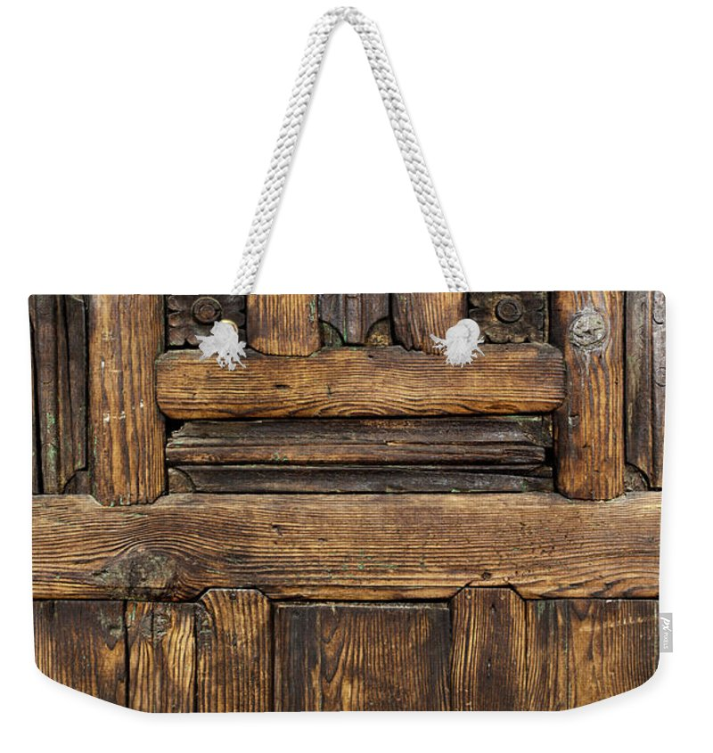 Arch Weekender Tote Bag featuring the photograph Old Wooden Door by Logosstock