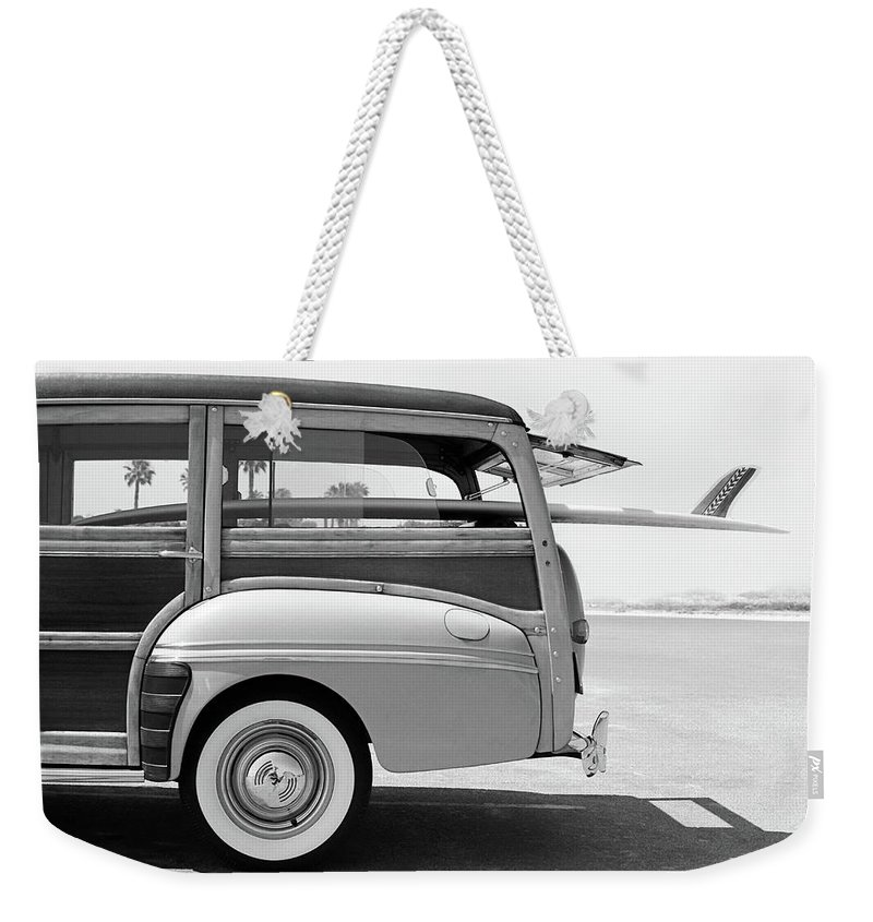 1950-1959 Weekender Tote Bag featuring the photograph Old Woodie Station Wagon With Surfboard by Skodonnell