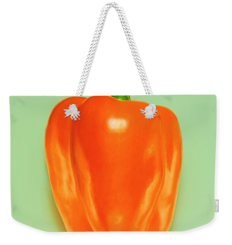 Orange Color Weekender Tote Bag featuring the photograph Orange Pepper by Adrian Burke