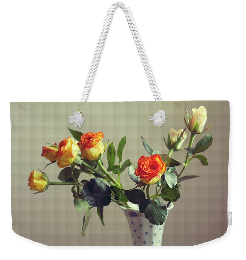 Orange Color Weekender Tote Bag featuring the photograph Orange Roses In Vintage Vase by Copyright Anna Nemoy(xaomena)