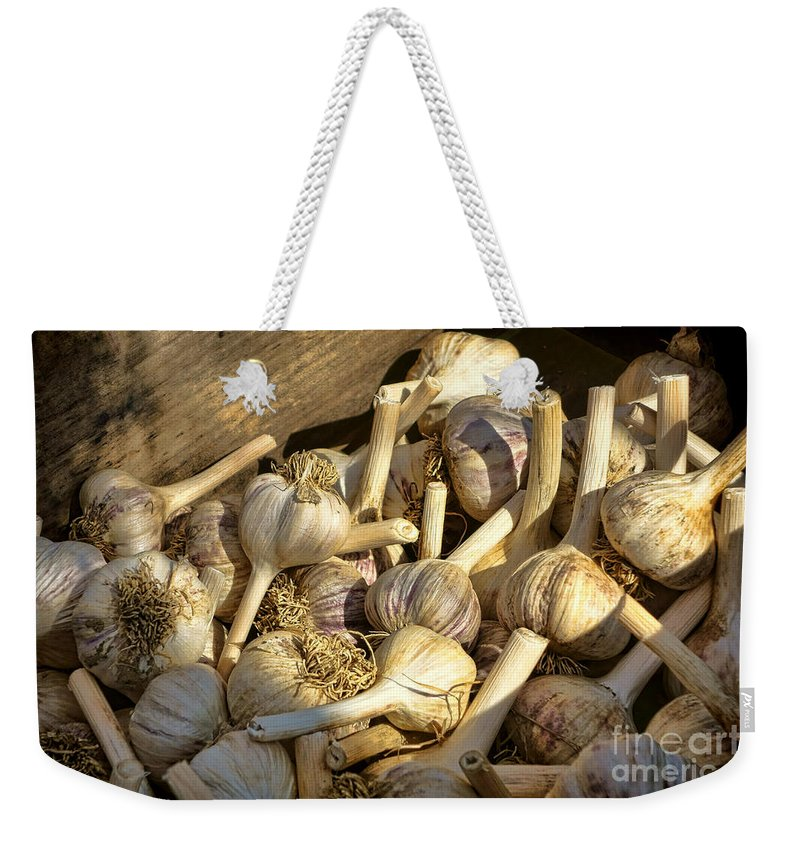 Garlic Weekender Tote Bag featuring the photograph Organic Garlic by Olivier Le Queinec