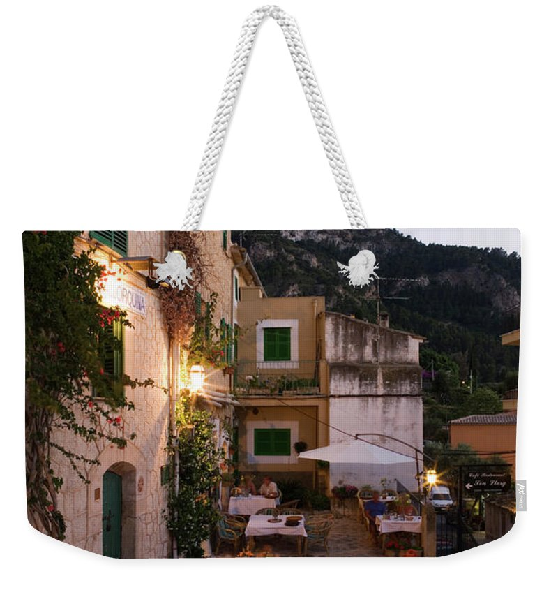 People Weekender Tote Bag featuring the photograph Outdoor Seating At Son Llarg Restaurant by Holger Leue