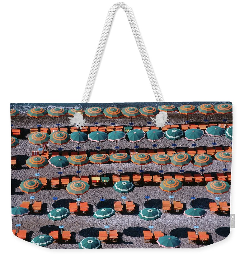Shadow Weekender Tote Bag featuring the photograph Overhead Of Umbrellas, Deck Chairs On by Dallas Stribley