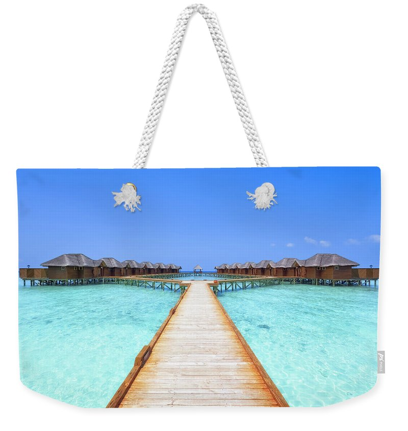 Beach Hut Weekender Tote Bag featuring the photograph Overwater Bungalows Boardwalk by Cinoby