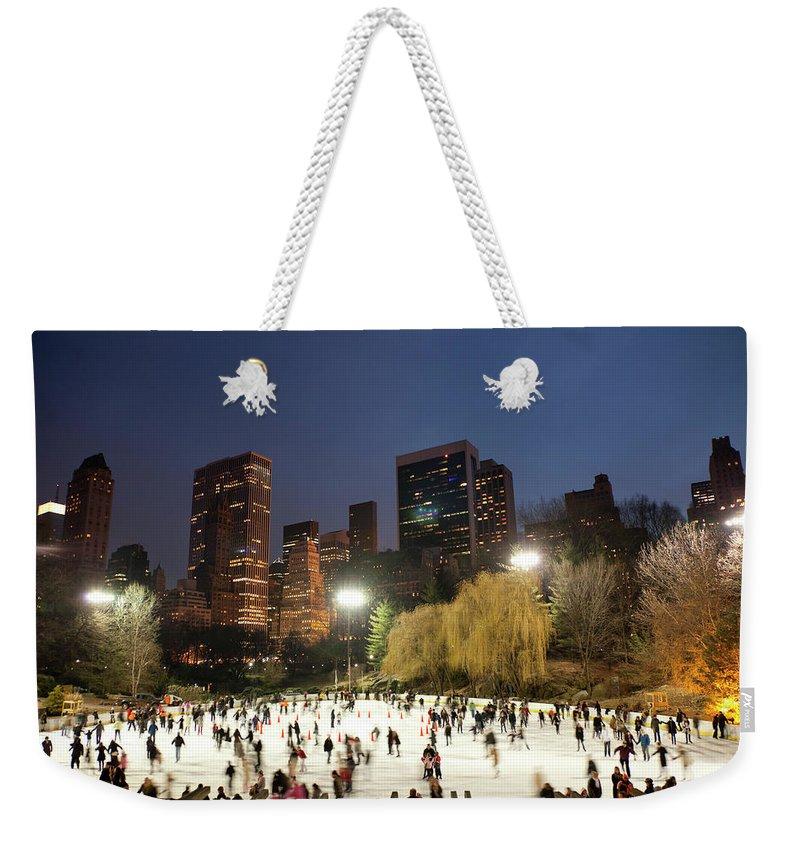 People Weekender Tote Bag featuring the photograph Panorama Of People Ice Skating In by Studiokiet