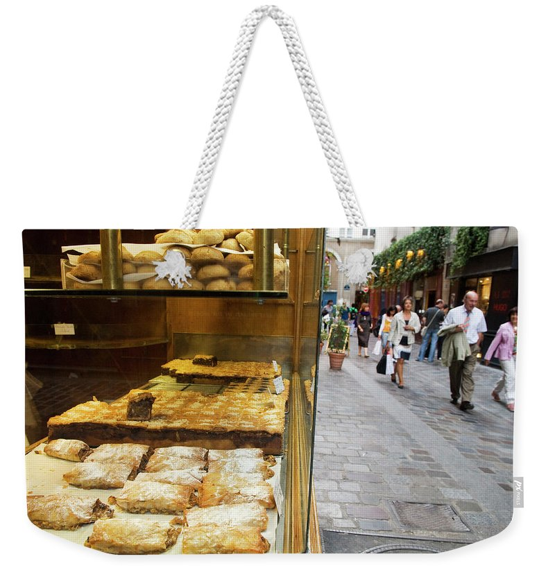 Pedestrian Weekender Tote Bag featuring the photograph Pastry Shop Along Rue Des Rosiers In by Lonely Planet