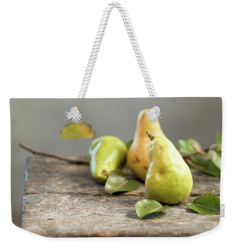 Vitamin Weekender Tote Bag featuring the photograph Pears by Sanjeri