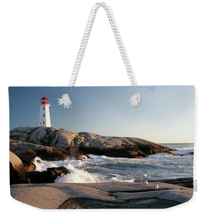 Water's Edge Weekender Tote Bag featuring the photograph Peggys Cove Lighthouse & Waves by Cworthy
