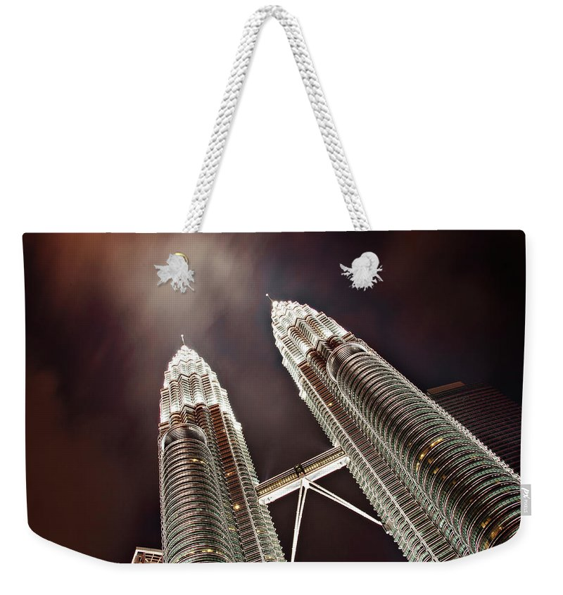 Directly Below Weekender Tote Bag featuring the photograph Petronas Towers by Smerindo schultzpax