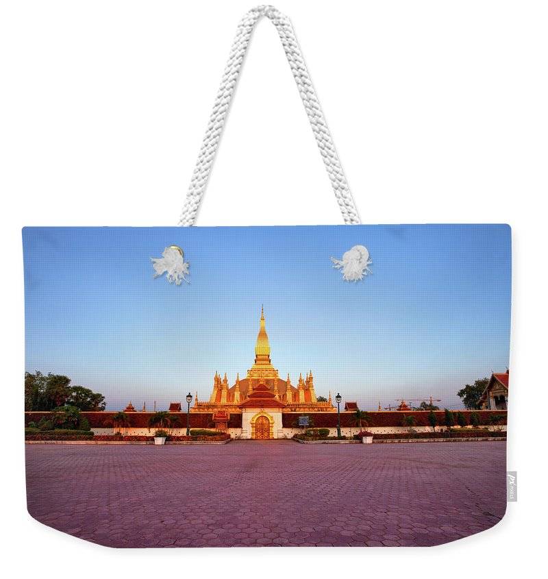 Monument Weekender Tote Bag featuring the photograph Pha That Luang Stupa At Sunset by Fototrav