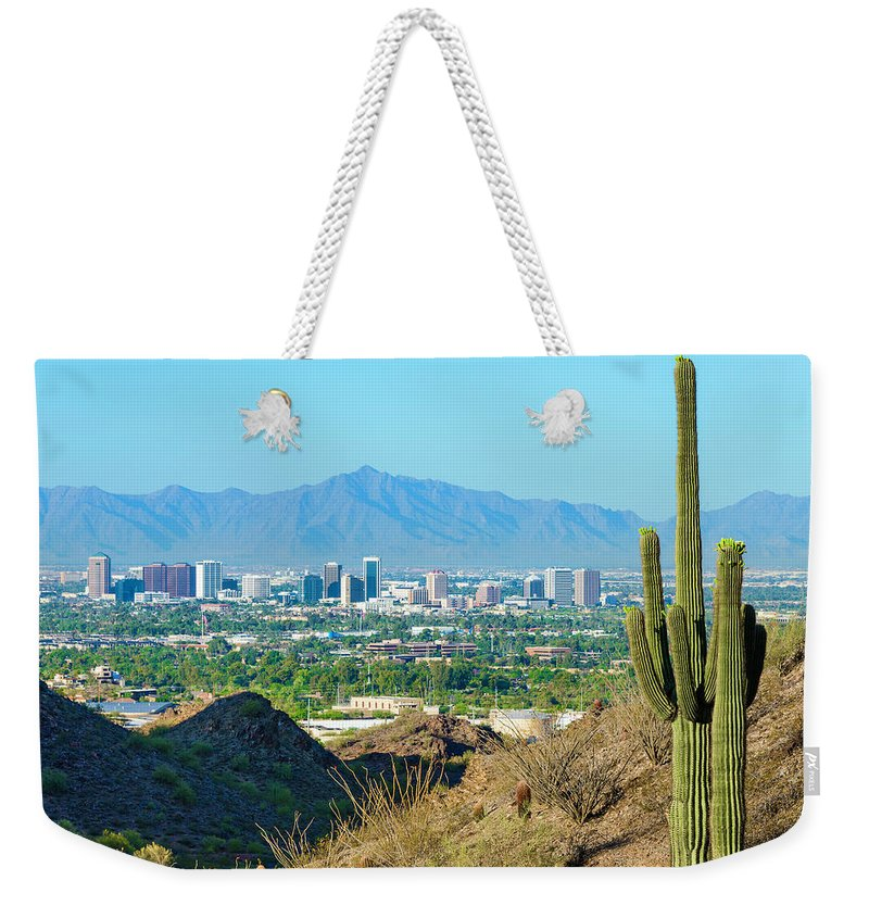 Saguaro Cactus Weekender Tote Bag featuring the photograph Phoenix Skyline Framed By Saguaro by Dszc