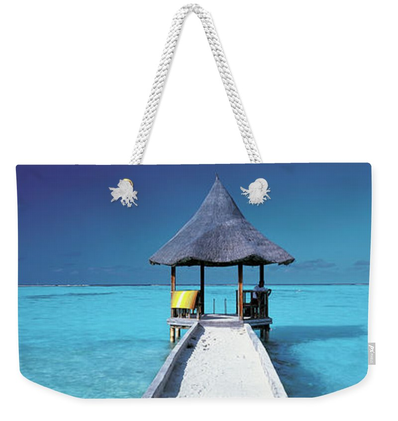 Tranquility Weekender Tote Bag featuring the photograph Pier And Blue Indian Ocean, Maldives by Peter Adams