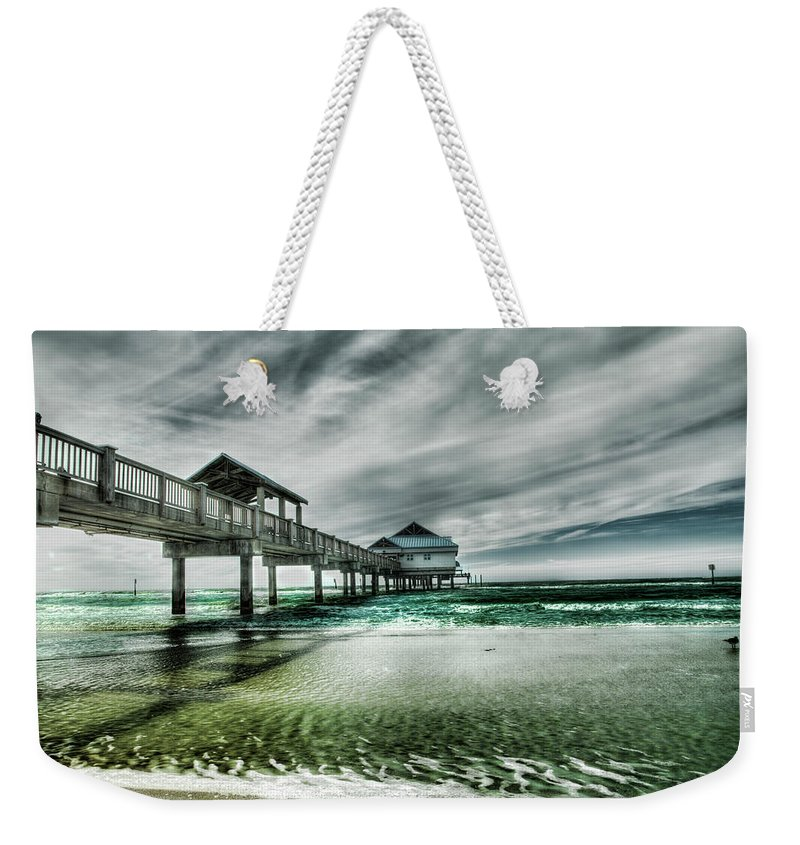 Water's Edge Weekender Tote Bag featuring the photograph Pier by Chumbley Photography