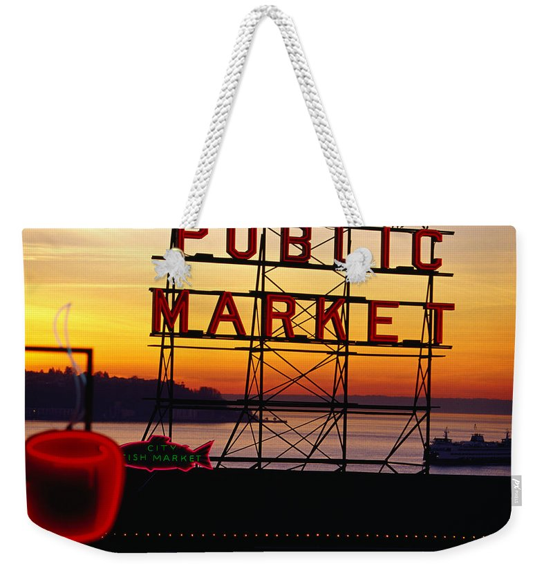 Ferry Weekender Tote Bag featuring the photograph Pike Place Market Sign, Seattle by Lonely Planet