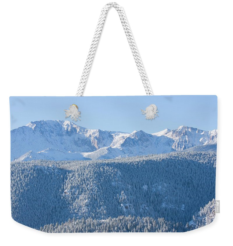 Extreme Terrain Weekender Tote Bag featuring the photograph Pikes Peak In Fresh Snow by Swkrullimaging