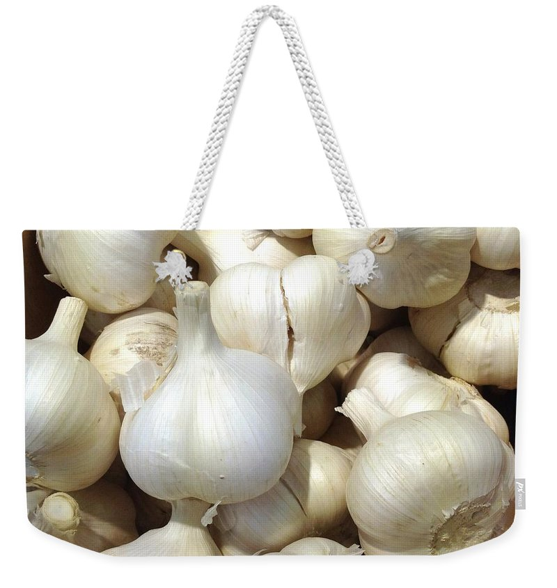 Heap Weekender Tote Bag featuring the photograph Pile Of Garlic by Digipub