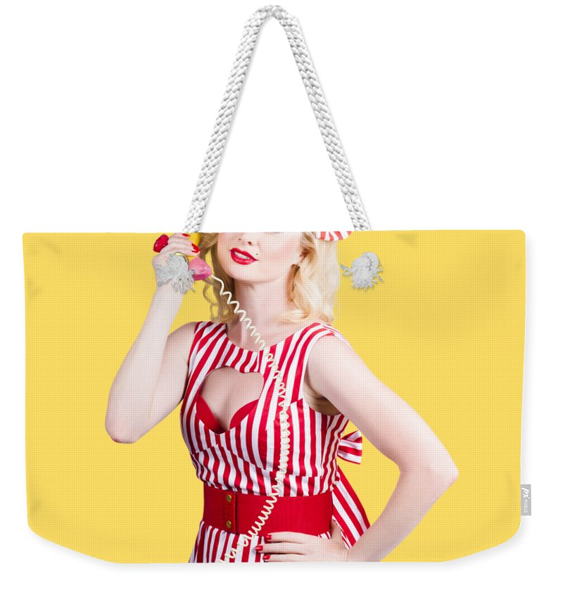 Pinup Weekender Tote Bag featuring the photograph Pin Up Woman Ordering Organic Food On Banana Phone by Jorgo Photography - Wall Art Gallery
