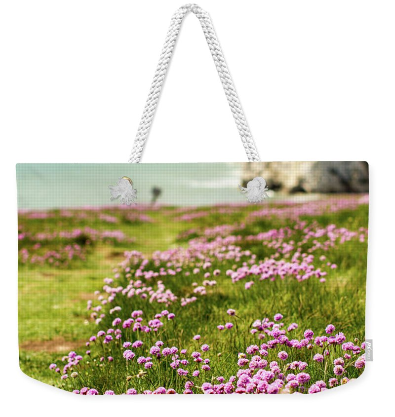 Scenics Weekender Tote Bag featuring the photograph Pink Coastal Path by S0ulsurfing - Jason Swain