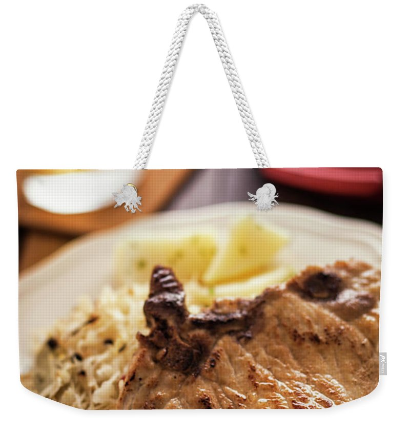 Meat Chop Weekender Tote Bag featuring the photograph Pork Chop And Sauerkraut by Gmvozd