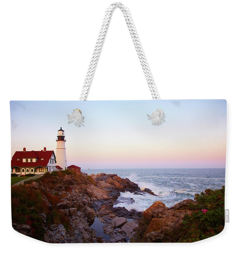 Scenics Weekender Tote Bag featuring the photograph Portland Head Lighthouse At Sunset by Thomas Northcut