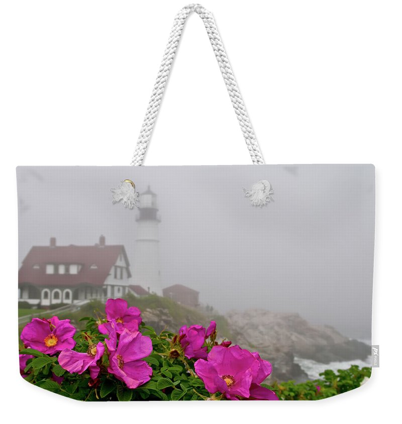 Built Structure Weekender Tote Bag featuring the photograph Portland Headlight With Rosa Rugosa And by Www.cfwphotography.com