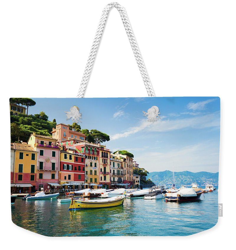 Water's Edge Weekender Tote Bag featuring the photograph Portofino, Liguria, Italy by Brzozowska