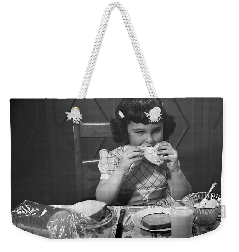 Milk Weekender Tote Bag featuring the photograph Portrait Of Little Girl Eating Buttered by George Marks