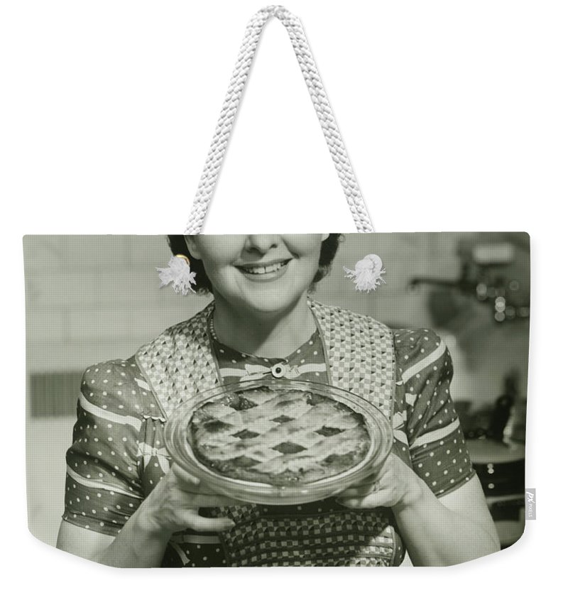 Mature Adult Weekender Tote Bag featuring the photograph Portrait Of Mature Woman Holding Pie by George Marks