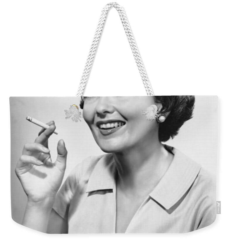 Smoking Weekender Tote Bag featuring the photograph Portrait Of Woman Holding Cigarettte by George Marks