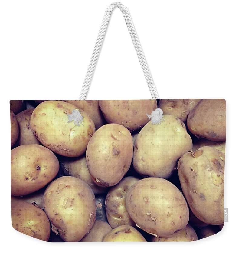 Heap Weekender Tote Bag featuring the photograph Potatoes by Digipub