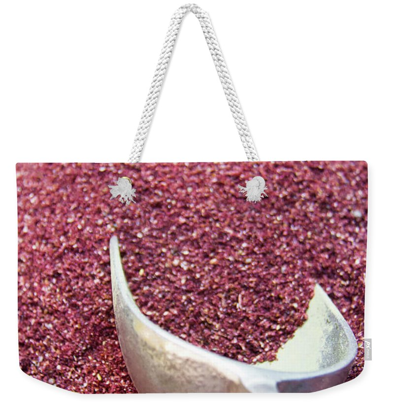 Spice Weekender Tote Bag featuring the photograph Powder Spices by Lluís Vinagre - World Photography