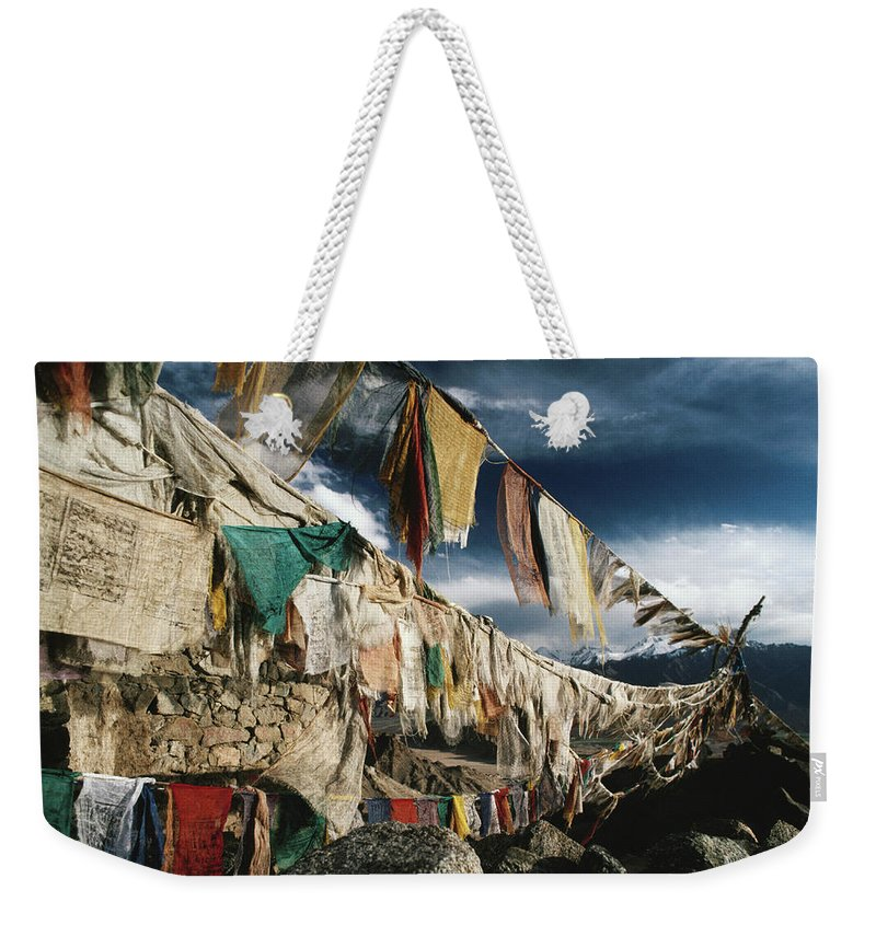 Himalayas Weekender Tote Bag featuring the photograph Prayer Flags Above Leh, Ladakh, Leh by Richard I'anson