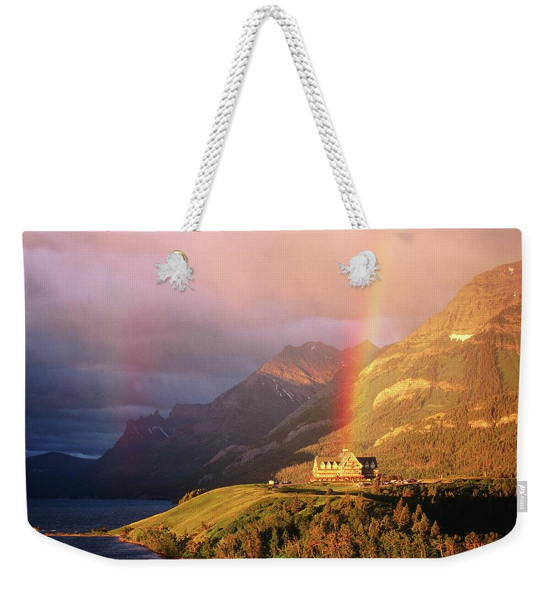 Scenics Weekender Tote Bag featuring the photograph Prince Of Wales Hotel, At The End Of A by John Elk