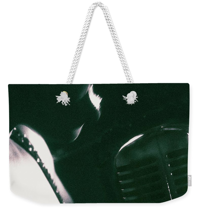 Singer Weekender Tote Bag featuring the photograph Profile Of Woman Singing Into Microphone by Digital Vision.