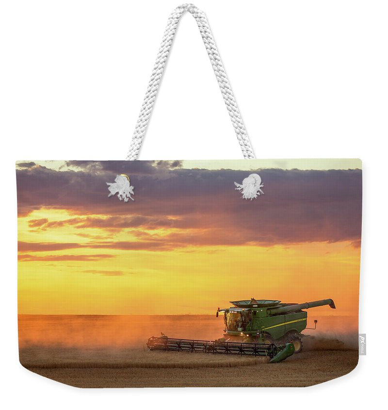 Combine Weekender Tote Bag featuring the photograph Purple And Orange by Todd Klassy