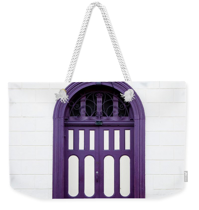 Arch Weekender Tote Bag featuring the photograph Purple On White by Anknet
