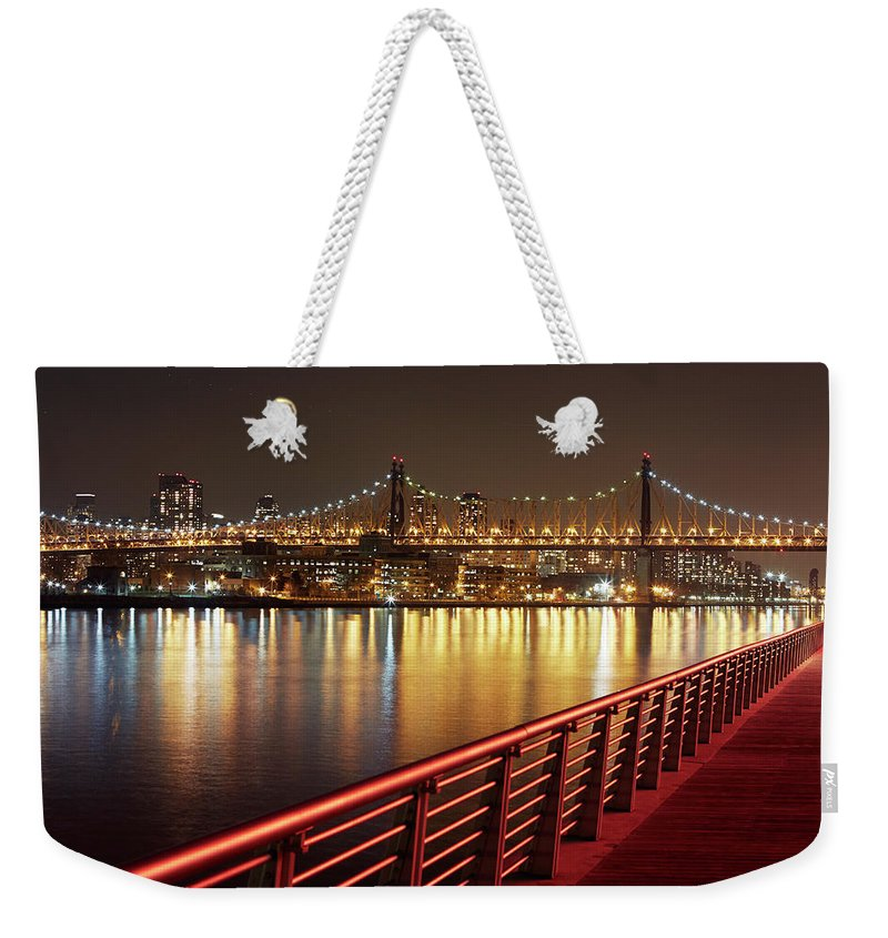 Built Structure Weekender Tote Bag featuring the photograph Queensboro Bridge At Night by Allan Baxter