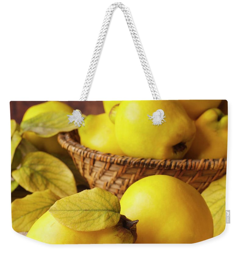 Quince Weekender Tote Bag featuring the photograph Quinces by Syolacan