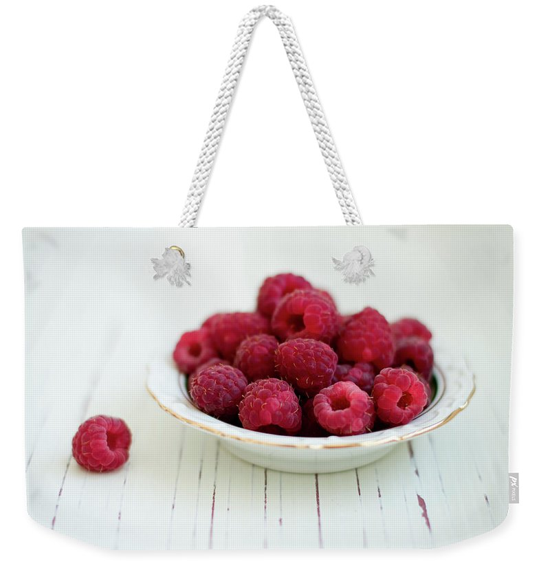 Outdoors Weekender Tote Bag featuring the photograph Raspberry In Vintage Plate On White by Copyright Anna Nemoy(xaomena)