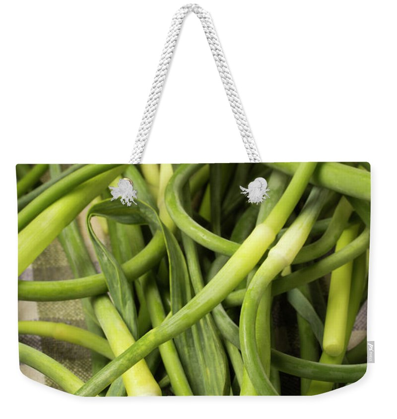 Season Weekender Tote Bag featuring the photograph Raw Garlic Scapes by Brian Yarvin