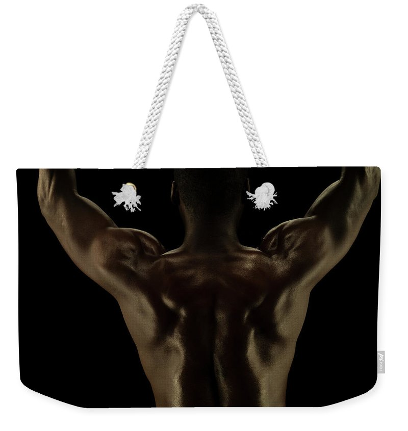 Human Arm Weekender Tote Bag featuring the photograph Rear View Of Athletic Male, Detail Of by Jonathan Knowles