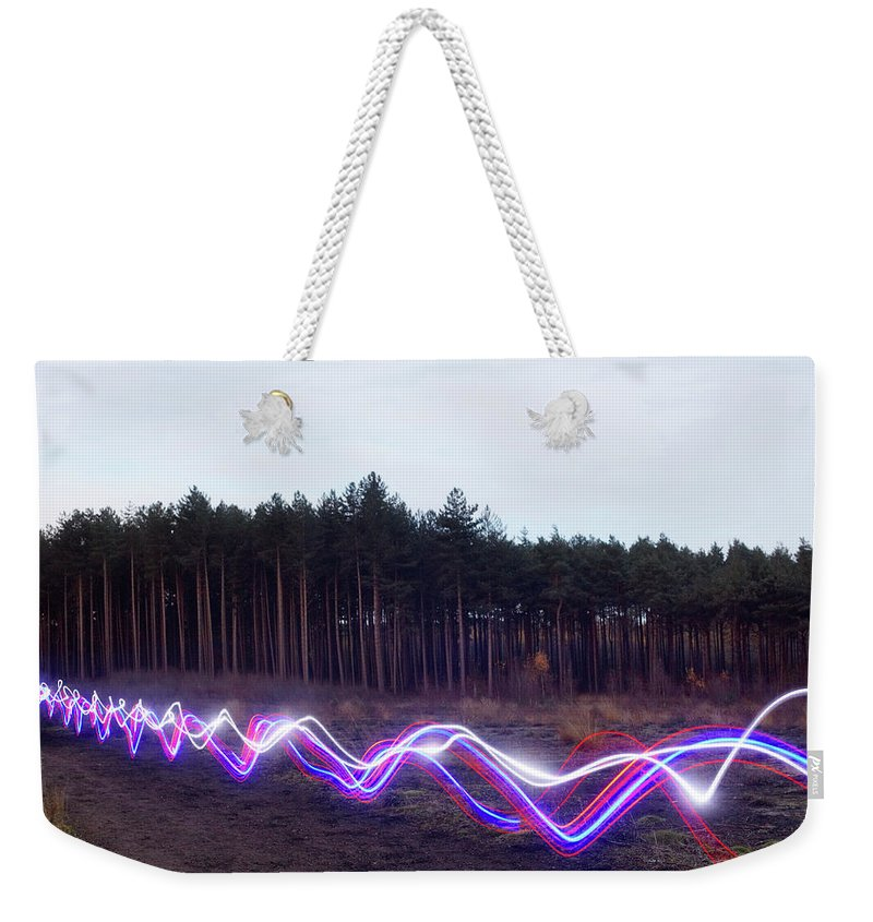 Internet Weekender Tote Bag featuring the photograph Red, Blue And White Light Trails On by Tim Robberts