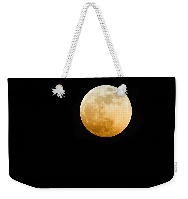 Shadow Weekender Tote Bag featuring the photograph Red Moon by Stevedangers