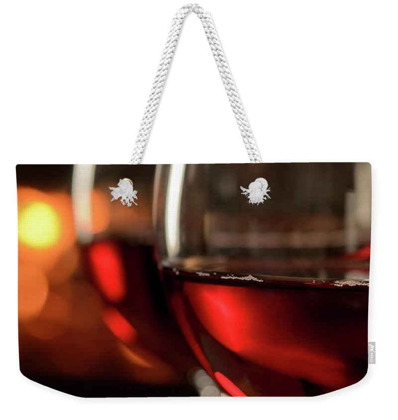 Orange Color Weekender Tote Bag featuring the photograph Red Wine By The Fire by Nightanddayimages