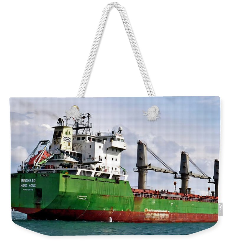 Redhead Weekender Tote Bag featuring the photograph Redhead Freighter by Gregory Steele